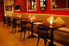 very small restaurant design | The sofas were soft and inviting, the cream color dashing to the soft ...