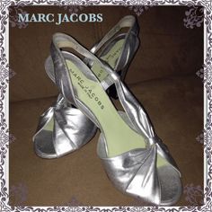 """MARC JACOBS Silver Peep-Toe Sling Back Shoes! Fabulous MARC JACOBS Silver Peep-Toe Sling Back Shoes! Features silver leather material, elegant peep-toe front & 4 1/4"""" heels. Measures 3 1/4"""" widest across, 9 1/2"""" from toe to heel on inside. Size 36 1/2 or 6 1/2. 100% authentic & Made in Italy. Some light marks on ext leather. VG condition. OFFERS WELCOME R☑️ Marc Jacobs Shoes"""