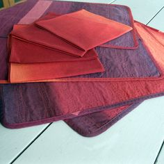"""This placemat/napkin set of four will add warm color and comfort to your table setting. The Marimekko print """"Selanne"""" has all the gorgeous shades of autumn – old mauve, purple taupe, rosewood, sienna, burnt orange and claret. The placemats are reversible – one side features the taupe and brown colors of Selanne and the other side features the claret and burnt orange colors."""