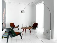 Designer Nacho Polo display the #Arco floor lamp to stunning effect.