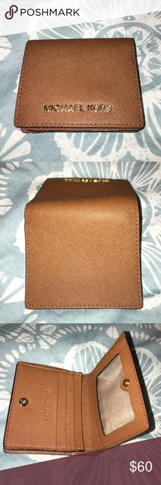 Michael Kors small wallet! Never used MK small wallet with a license pocket and 3 card pockets plus one larger card pocket as well as a cash slot. A single snap button close--gold hardware. Michael Kors Bags Wallets
