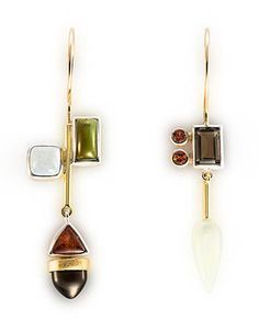 "Janis Kerman: , Earrings in sterling silver, 18k yellow gold, aquamarine, tourmaline, hessonite garnet, smokey quartz, serpentine, and orange sapphire. Approx 2 1/4"" long."