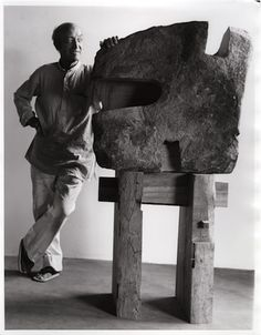 """Happy 110th birthday, Isamu Noguchi! Photograph of Noguchi with his sculpture The Inner Stone, 1980  The Noguchi Museum Archive """