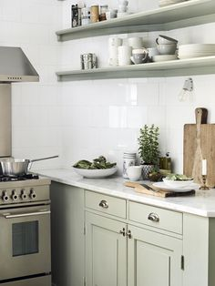 Staggered white square subway tiles with white grout