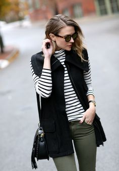 Black sweater vest + striped shirt + olive jeans