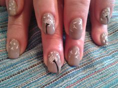 wind blown dandelions on taupe gel