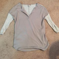 Grey XS Banana Republic top . Size XS grey top from Banana Republic. Has knit back and sleeves with a great neckline and dressier front. Can be worn with jeans for Stylish casual outfit or can be dressed up with slacks for office wear, Banana Republic Tops Blouses