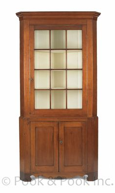 Pennsylvania Federal Cherry two-part corner cupboard, early 19th century, 88 H. x 41.5 W.
