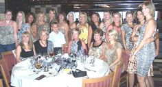 Dinner group shot with all the girls dressed in animal print.