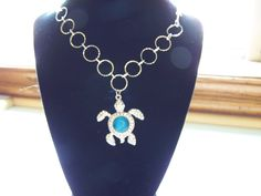 Silver necklace with turtle