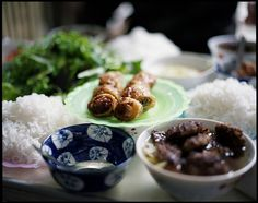 Bun Cha (Vietnam). 'This street favourite features barbecued  sliced pork or pork patties served with  thin rice vermicelli, a heap of fresh herbs  and green vegetables, and a bowl of lightly  sweetened nuoc mam (fish sauce) with floating  slices of pickled vegetables. The Hanoi  version combines sliced pork belly and pork  patties formed from chopped pork shoulder.' http://www.lonelyplanet.com/vietnam