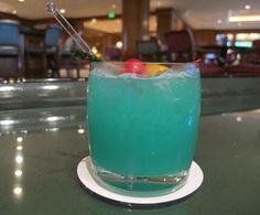 BLUE LAGOON(TEQUILA)  1.5 oz Jose Cuervo Tequila  •  Blue Curacao  •  Orange and Pineapple Juices
