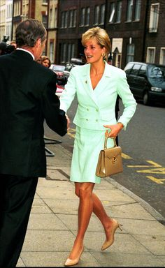 """February 14, 1997: Diana, Princess of Wales for """"Gold Heart Day"""" during her visit to Great Ormond Street Hospital for Children to open a new Renal Unit."""