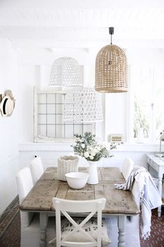 A beautiful dining space in white and neutrals and with several painted and non-painted wicker lampshades over it. Beach Cottage Style, Beach Cottage Decor, Coastal Decor, Coastal Style, Coastal Cottage, Chic Beach House, Cottage Art, Romantic Cottage, White Cottage