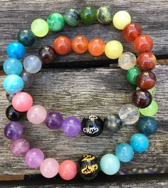 Unisex Chakra Bracelet with Large Black Onyx Bead Engraved With OM – Reiki Charged