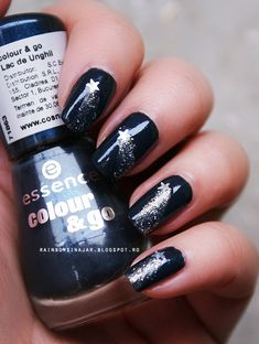 Shooting stars. Perfect: a black that's NOT goth. Love. It's like the perfect little black dress but for your nails