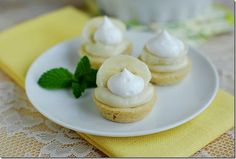 Mini Banana Cream Pies.  Mini Banana Cream Pies are the perfect party appetizer.  Shortbread cookie dough form the shells of these mini pies which are filled with creamy vanilla pudding then topped with whipped cream and a fresh banana slice.