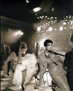 Carmen Dell Orefice in lace cocktail ensemble designed by Yves Saint Laurent for Christian Dior , photo by Avedon for Harper's Bazaar at Folies Bergere, Paris, 1957