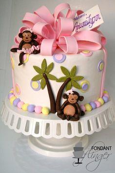 CUTE monkey cake with big bow and adorable little palm trees....LOVE Fondant Flinger's work (Rachel in Kodiak, AK)