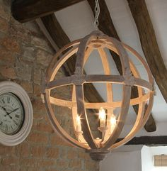 large round wood chandelier by cowshed interiors | notonthehighstreet.com