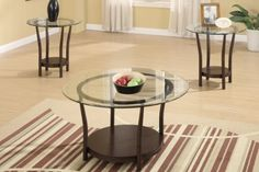 Make this 3-piece coffee #table set the center of attention in your living room. With clear glass circular tabletops and simple round wood base and legs this is ...