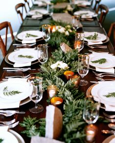The other tables were adorned with slabs of flagstone holding platters of food and garlands of ferns extending down the middle. Each place setting was also topped with a fern. Overall, the reception setup was intended to feel as natural as possible to suit the surroundings.