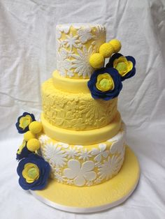 A vintage flowered-lace cake by Christie's Cakes Ottawa, inspired by the theme for a stylized spring wedding photo shoot with Anna Jones Photograpy and Charmed Events. The ranunculus and craspedia are handmade from sugar paste and the lace detail was individually appliqued.