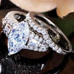 Matrimony Marquise Ring. I'd want a different cut center diamond though.