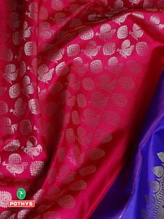 The gleaming magenta Samudrika silk saree with magnificent peacock motifs and contrast blue pallu with intricate silver threadwork gives the festivity vibe with a vibrant elegant look. Style it with temple jewelry to make it more attractive. #pothys #pothyssarees #silksaree #puresilksaree #silksaree #samudrikasaree #ethnicsaree #traditionalsaree #puresilk #sareedesigns #sareedrapping #sareelove #bluesaree #pattusaree #kanchipuram #samudrikapattusaree #purekanchipuramsaree #sareemodels #saree
