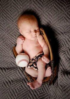 Baby in baseball glove.