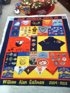 This is a Cub scout quilt that I made using t-shirts, bandana's, patches, etc. Great memory quilt. This photo was taken right before I sealed it up.