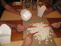 Minute to Win It Game: How many marshmallows can you pick up with chopsticks game...would be fun as one of our advent activities. Followed by hot chocolate of course