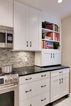 love the tile backsplash, white cabinets, & dark countertops