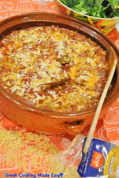 """""""Giouvetsi"""" is the term used for a baked Greek dish made with chicken, lamb or beef and pasta, either kritharaki (orzo) or hilopites in tomato sauce. In this recipe, the combination with Cretan Village Orzo, sweet Tomato & Wine sauce and clay-pot baking results in an amazing rural dish! #κοτόπουλο #γιουβέτσι #chicken #giouvetsi #orzo #Eatgreek #crete #homemadefood #greece #greek #greekrecipes #hereismyfood #delicious #homecooking #συνταγες #greekcookingmadeeasy #love #instagreece #greekcuisine"""
