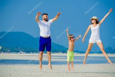 Happy young family of three having fun on the desert sunny beach Royalty Free St , #Ad, #fun, #desert, #family, #Happy #AD