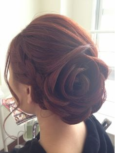 Soft rose shaped bun. Not sure if lots of hairspray needed to hold this up!