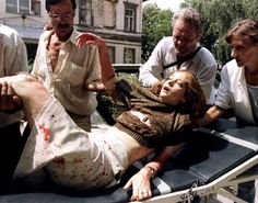 A wounded Bosnian woman is brought to Kosevo hospital in Sarajevo, July 26, 1995. (Photo by Reuters)