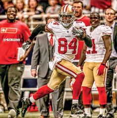 Brandon Lloyd with his 82 yard catch for a TD against the Rams Professional Football Teams, Patrick Willis, Champion Sports, San Francisco 49ers, Football Helmets, Tops, Yard, Future, Patio