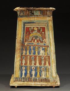 Egyptian wood and polychrome stucco canopic chest, early Ptolemaic, ca 4th century BC