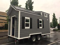 This is the Brookside by Blue Elk Tiny Homes in Kentucky that's currently for sale. The little home comes with metal roofing and pretty slate grey siding, and packs in a kitchen, living room,…
