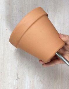 Stick a metal rod through a terra cotta pot (super useful wall idea!)