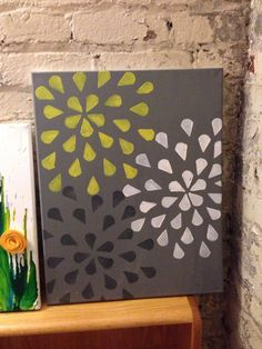Cute DIY pic on canvas my sister inlay made for her new grey and yellow room. Different make up sponges do wonders!