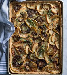 Savory Apple Tart with Onions, Cheddar and Thyme | This recipe puts a fresh spin on the classic apple tart, transforming it into a savory version. Serve as a hearty appetizer, or pair with a tossed green salad for a light lunch or supper.