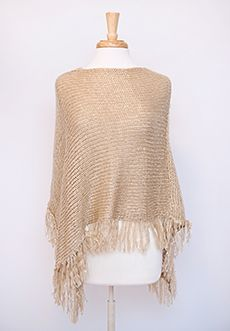 "Homecoming Trunk Shows - Looking for a versatile piece that is comfortable, practical and still stylish? This gorgeous poncho has got your covered – the material is soft, the edges are fringed and little sequins glitter with movement.  Perfect for those outdoor soccer games or nights on the town, this one size fits most item also comes in gray.   - Approx 17"" (shortest point from opening); 30"" (longest point from opening)  - 100% acrylic  - Dry clean only  - Imported"