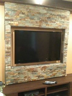 TV wall mount and entertainment center, Wall framed and covered in natural stone for my massive 55 inch HDTV, What do you guys think.., Living Rooms Design