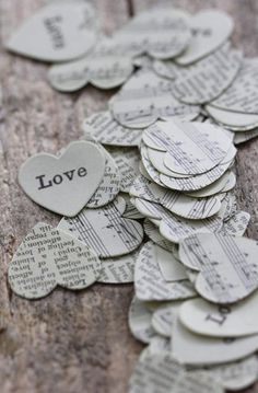 love confetti with a heart shaped hole punch on a music sheet - love the idea! wish I had the shape though...