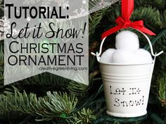 Tutorial for an easy ornament that looks like a  small bucket of snow balls! Super cute and uses supplies from the dollar store, too.