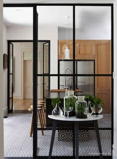 Looking through...great way to divide a room, adn could always have a pull down shade for privacy if desired
