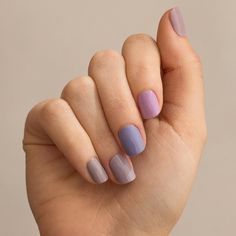 Each nail a different shade of purple