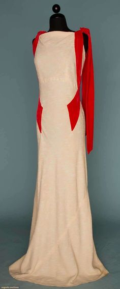 "CREAM SILK EVENING GOWN, MID 1930s  Bias cut, cream & ivory slub weave crepe, persimmon velvet bands criss-cross on sides & tie at shoulders, B 36"", Hi W 30"", L 64"", excellent."